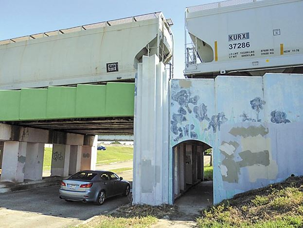 Irises painted on the railroad overpass on Marconi Drive have faded, but the railroad company has painted part of the bridge, mostly to warn trucks that are too tall to clear the structure.