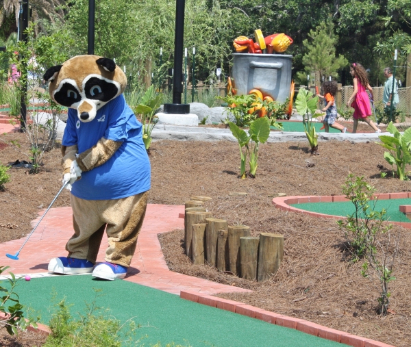 Parker, City Park's mascot, takes his turn at City Putt.