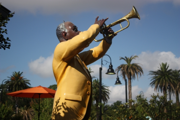 Louis Armstrong plays over the New Orleans Course.