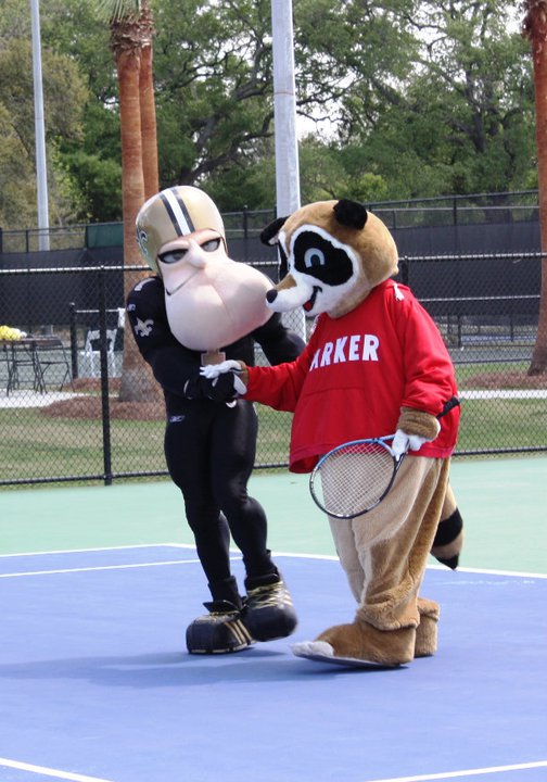 Sir Saint and Parker, the City Park mascot, discuss the latest Saints season while playing a round of Tennis.