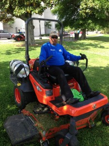 Long-time City Park employee Sylvester with one of our new propane fueled mowers.